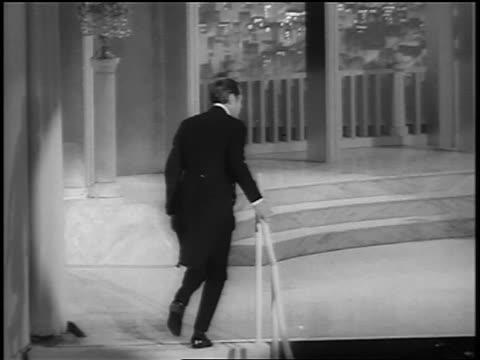 rex harrison walking onstage hugging audrey hepburn at academy awards - audrey hepburn stock-videos und b-roll-filmmaterial