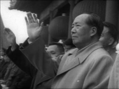 b/w 1960s chairman mao zedong raising hand during military parade / china / educational - mao tse tung stock videos & royalty-free footage