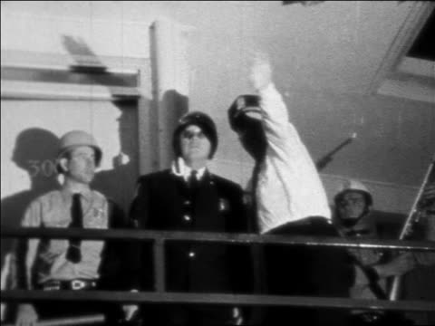 b/w 1968 policemen pointing on balcony at motel at night where ml king was assassinated / newsreel - martin luther religious leader stock videos & royalty-free footage