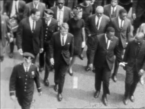 b/w 1968 high angle robert kennedy marching in funeral procession of martin luther king / newsreel - martin luther religious leader stock videos & royalty-free footage