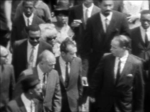 b/w 1968 high angle richard nixon marching in funeral procession of martin luther king / newsreel - martin luther religious leader stock videos & royalty-free footage