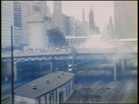 vidéos et rushes de crowd of anti-war protesters walking across overpass to downtown chicago / newsreel - 1968