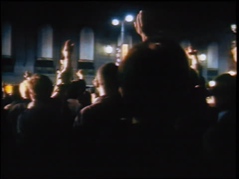 crowd raising arms at anti-war protest at night / chicago / newsreel - 1968 stock videos & royalty-free footage