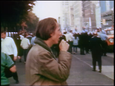 man coughing during tear-gassing at anti-war protest / crowd in background / chicago / newsreel - 1968 stock videos & royalty-free footage