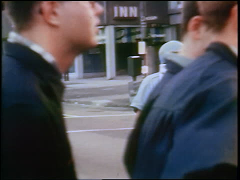 vidéos et rushes de policeman covering face + directing traffic during tear-gassing at anti-war protest / chicago - 1968