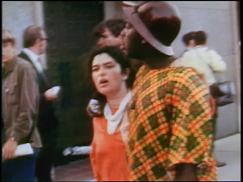 vidéos et rushes de interracial couple smiling to camera at anti-war protest / chicago, illinois / newsreel - 1968