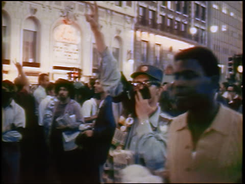 1968 man raising fingers in peace sign at antiwar protest / Chicago / newsreel