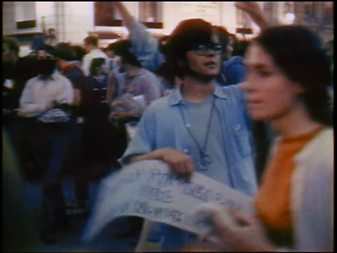 1968 hippie man with sign shouting in crowd on street at antiwar protest / chicago / newsreel - rad stock videos & royalty-free footage