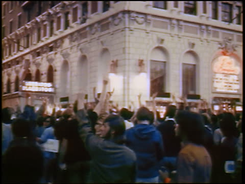 stockvideo's en b-roll-footage met view crowd raising arms at antiwar protest on street / chicago / newsreel - 1968