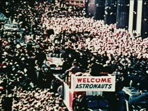 1962 high angle ticker tape parade for john glenn on nyc street / newsreel - ticker tape stock videos and b-roll footage