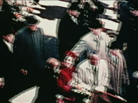 1962 high angle john glenn wife riding in convertible with lyndon johnson in parade / nyc / newsreel - 親指を立てる点の映像素材/bロール