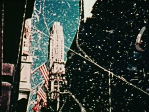 vídeos de stock e filmes b-roll de low angle tilt down ticker tape parade on nyc street for john glenn after flight / newsreel - super exposto
