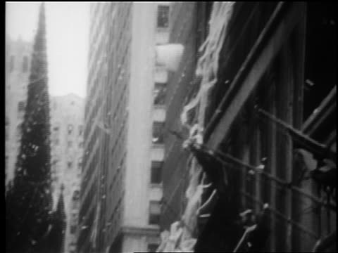 b/w 1969 tilt down confetti ticker tape falling on wall street in parade for mets after world series win - ticker tape stock videos and b-roll footage