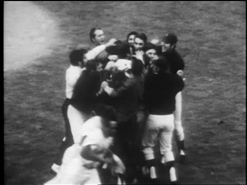 vídeos de stock e filmes b-roll de high angle mets team celebrating on field after winning world series / newsreel - 1969
