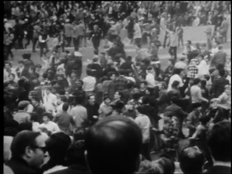 b/w 1969 high angle crowd celebrating on field after mets beat orioles to win world series / newsreel - 1969年点の映像素材/bロール