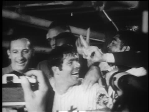 b/w 1969 close up pan excited mets players holding up #1 fingers after winning world series / newsreel - flushing meadows corona park stock videos and b-roll footage