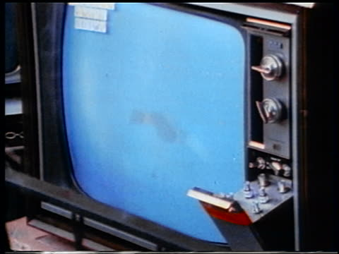 vídeos y material grabado en eventos de stock de 1970 close up apollo 13 space capsule attached to parachutes descending on television - 1970