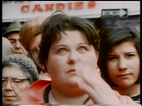 1970 close up heavy woman watching intently wiping eye outdoors
