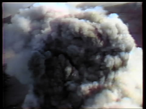 May 18 1980 AERIAL smoke pouring out of top of Mt St Helens during eruption / Washington