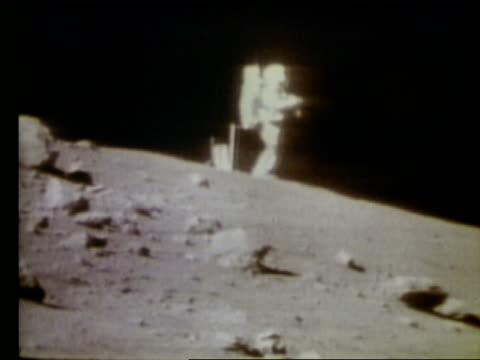 wide shot of astronaut standing on Moon