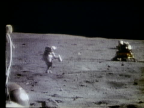 Astronaut running away from camera on Moon