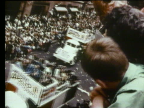 high angle of ticker tape parade for first men on moon / apollo 11 - paraden stock-videos und b-roll-filmmaterial