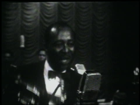 b/w 1950s/60s close up louis jordan singing choochoo chboogie on stage - brass instrument stock videos & royalty-free footage