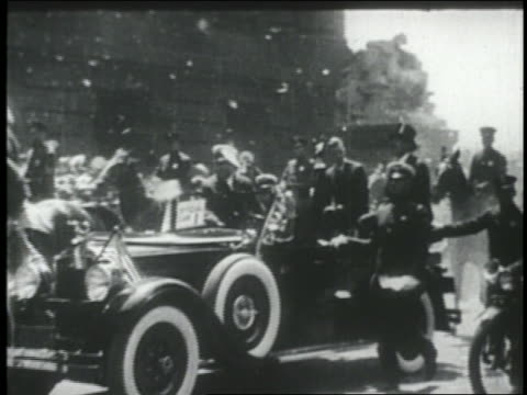 Charles Lindbergh sitting in car in ticker tape parade / NYC