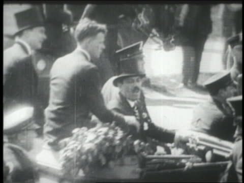 B/W 1927 high angle REAR VIEW Charles Lindbergh sitting in car in ticker tape parade / NYC