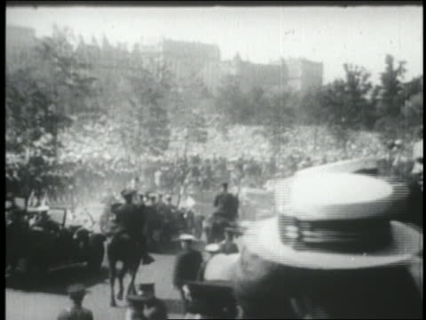 VIEW wide shot Charles Lindbergh's car at Central Park in ticker tape parade / NYC