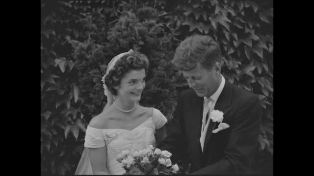 stockvideo's en b-roll-footage met newport ri / sen kennedy takes bride at newport / in fashionable newport ri us senator f kennedy marries socialite jacqueline lee bouvier in one of... - jacqueline kennedy