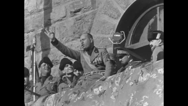 mussolini, benito italy florence. inspects fascisti legions on inspection tour of country / mussolini uniformed on horse reviewing legion at... - benito mussolini stock videos & royalty-free footage