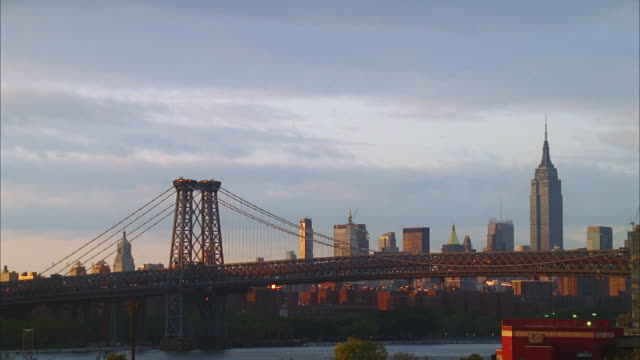 sunset various new york city shots with clouds (williamsburg bridge, empire state bldg., docks) - williamsburg bridge stock videos & royalty-free footage