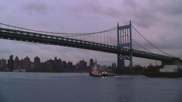 triborough bridge, new york; dark, cloudy sky - east river new york city stock videos & royalty-free footage