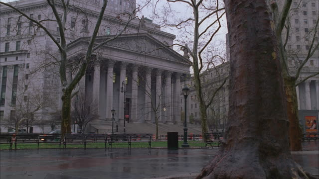 new york city supreme court house, foley square, new york, in  rain - bare tree stock videos & royalty-free footage