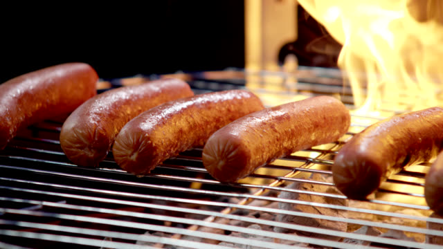 hotdogs on the grill-slow motion - grilled stock videos and b-roll footage