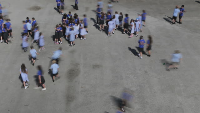 CHILDREN ON PLAYGROUND ELEVATED VIEW
