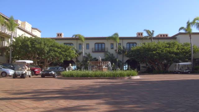 est. resort w/activity; palms (terranea resort, palos verdes, ca) - palos verdes stock videos & royalty-free footage