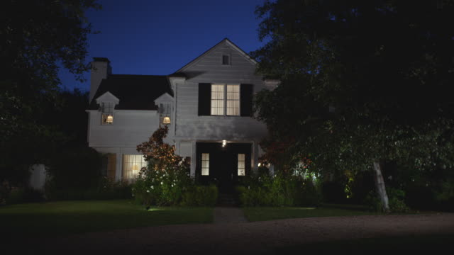 n/x upscale 2 - story house, lites on - grounds stock videos & royalty-free footage
