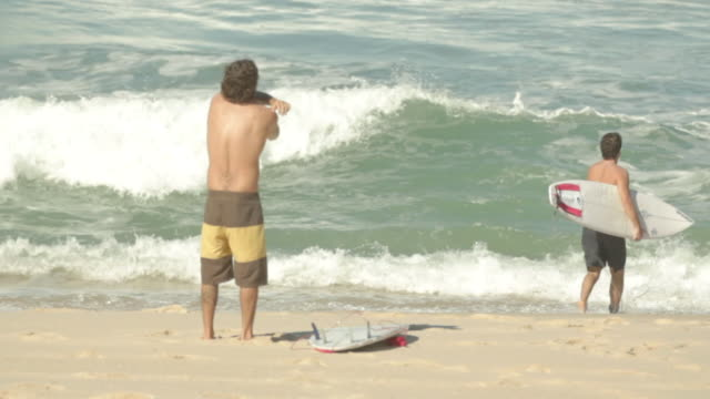 beach - swimming shorts stock videos & royalty-free footage