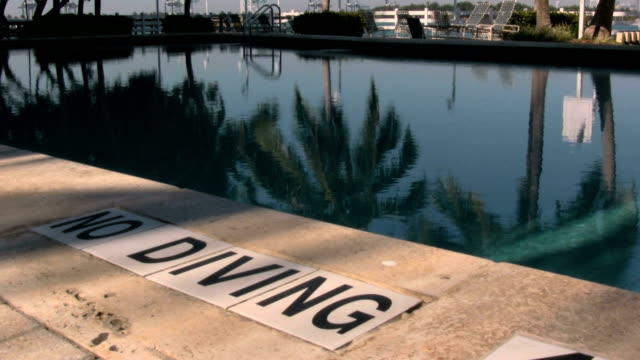 no diving - poolside stock videos and b-roll footage