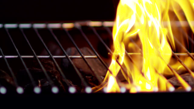 lighting a grill-slow motion - grilled stock videos and b-roll footage