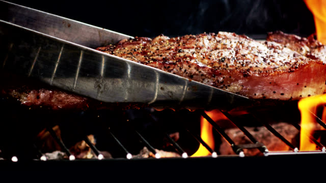grilled strip steak-slow motion - steak stock videos & royalty-free footage