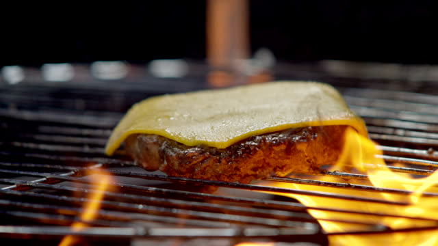 cheeseburger on the grill - hamburger stock videos and b-roll footage