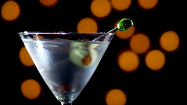 MARTINI WITH OLIVE DROPPED-SLOW MOTION