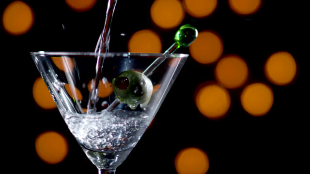 martini being poured-slow motion - martini stock videos & royalty-free footage