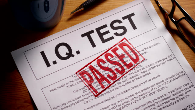 i.q. test form stamped approved and failed - representing stock videos and b-roll footage