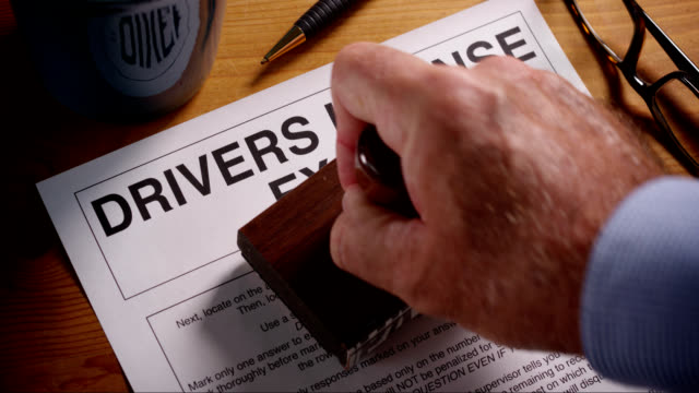 drivers exam form stamped approved and failed - driving test stock videos and b-roll footage