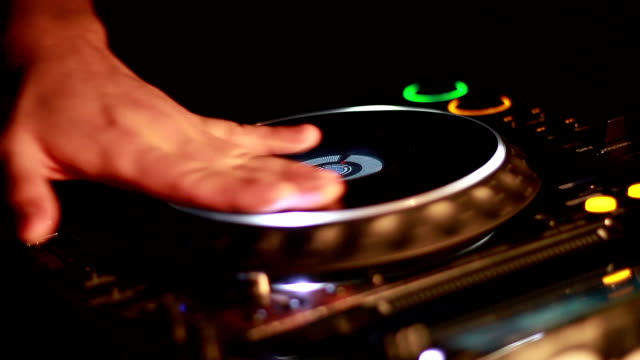 dj - mixing stock videos and b-roll footage