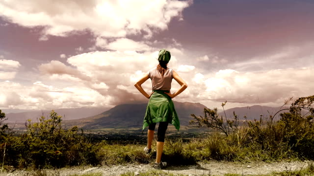TREKING TOURIST WATCHING A MOUNTAIN IN OTAVALO ECUADOR